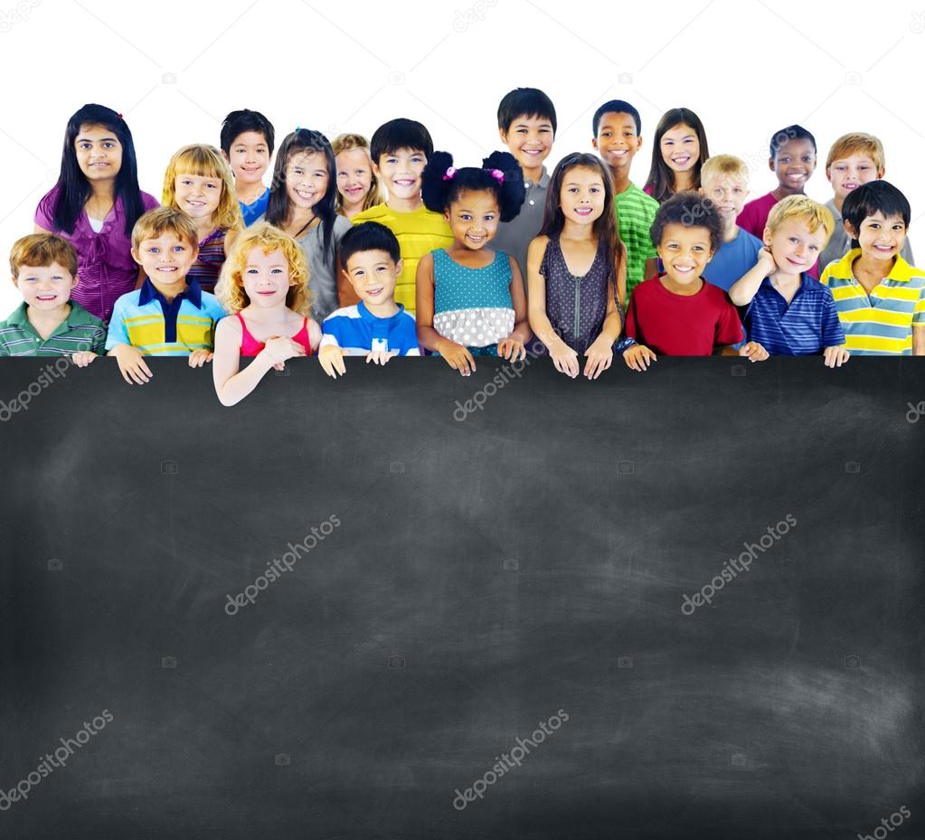 Group of Multiethnic children with blackboard