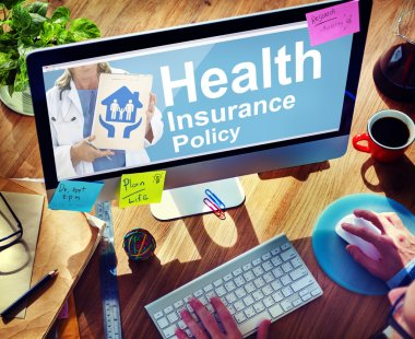 man using computer with Health Insurance Concept
