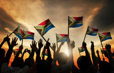 People Waving African Flags