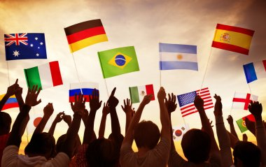 Group of People Waving National Flags