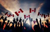Fotografie Group of People Waving Canadian Flags