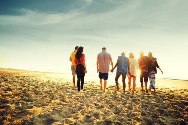 happy friends having fun on the beach