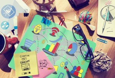 Messy office desk with Marketing Concept