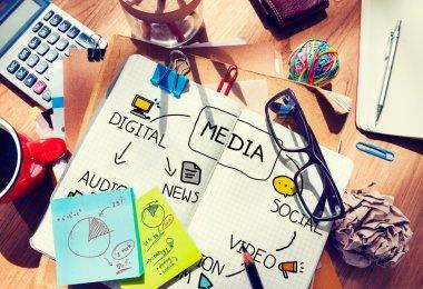 Messy office desk with Digital Media