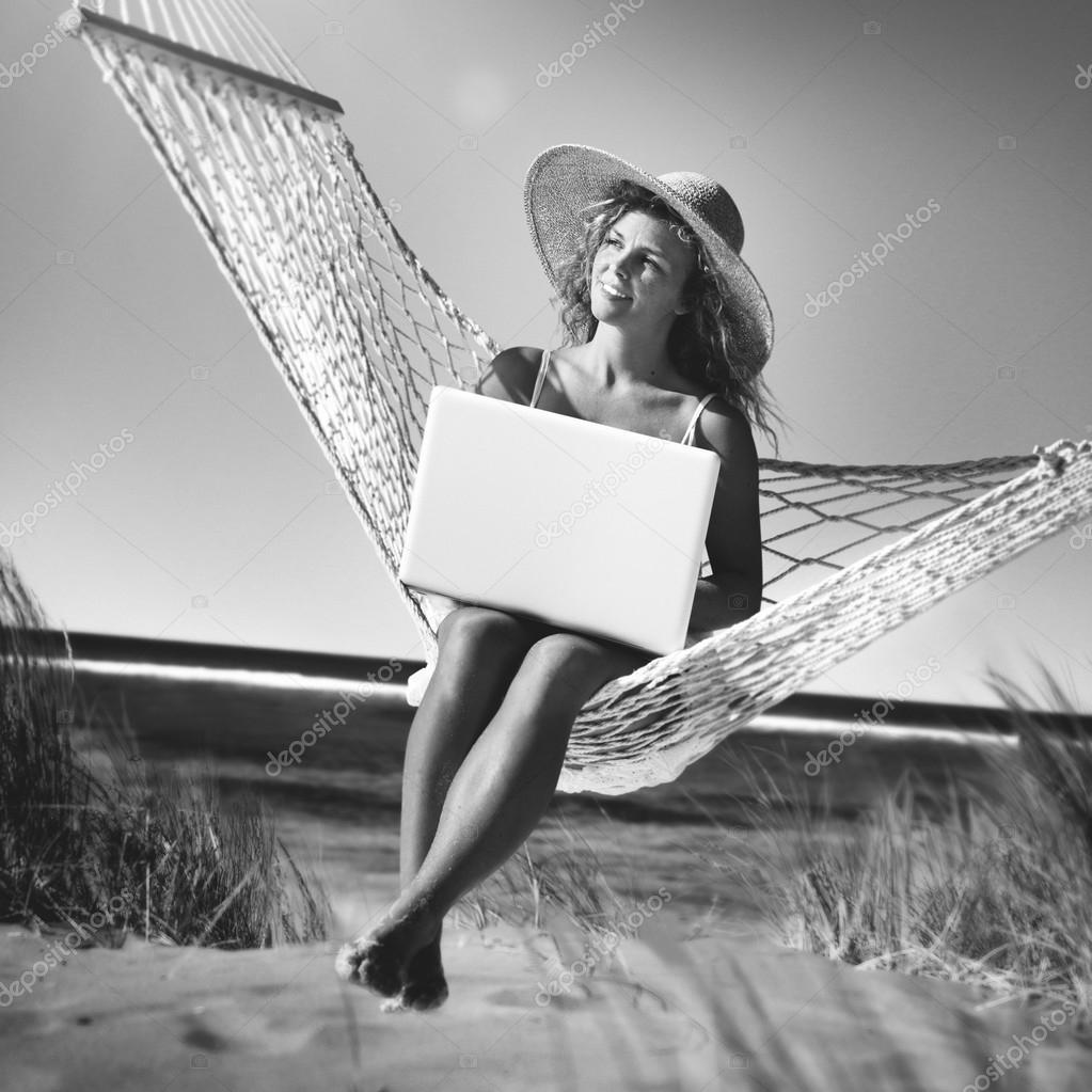 Woman Sitting on Hammock Concept