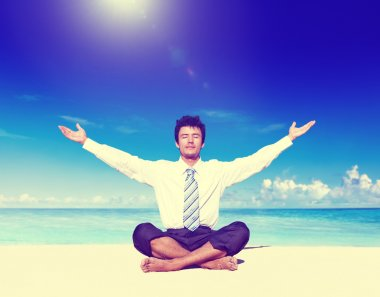 Businessman meditating on the beach Concept