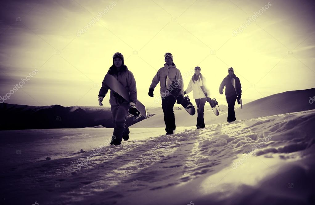 Snowboarders on Top of the Mountain Concept