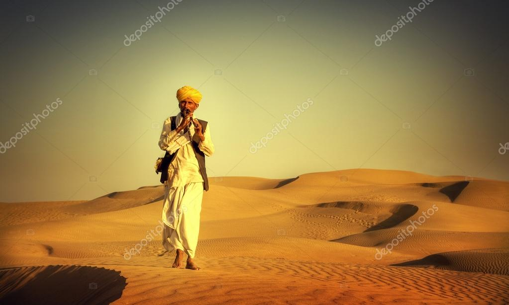 Indian Man Playing Wind Pipe Concept