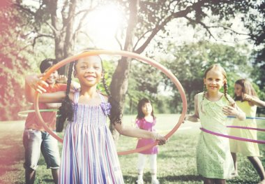 Children Playing Hula Hoop Concept