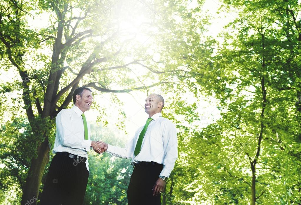 Green Business Handshake Businessmen