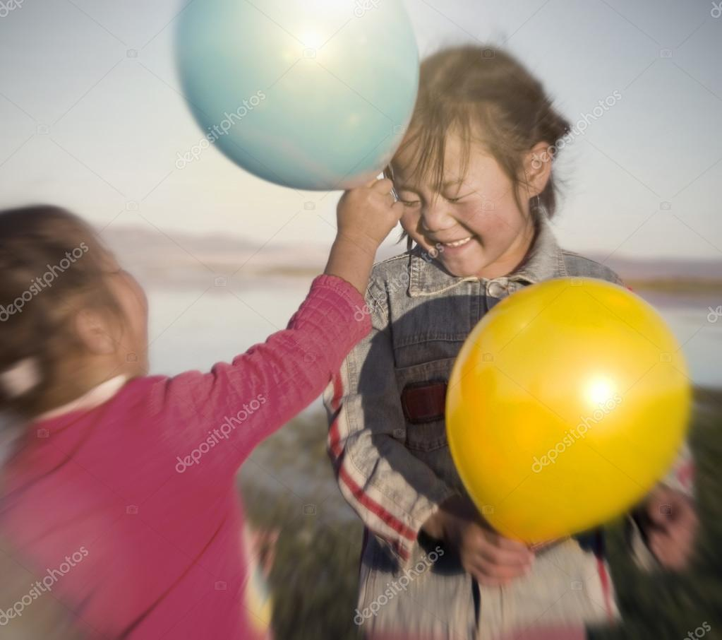 Little Girls Playing with Balloons
