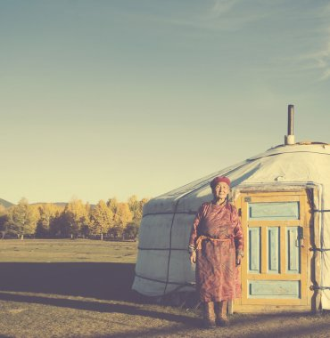 Mongolian Lady Standing at Tent