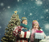 Fotografie Christmas Children with Gifts Concept