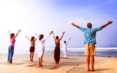 people doing exercise of yoga