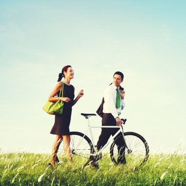 Business couple with bicycle