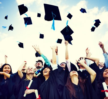 students Throw Caps in the Air