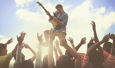 Young Man with Guitar Performing Concert
