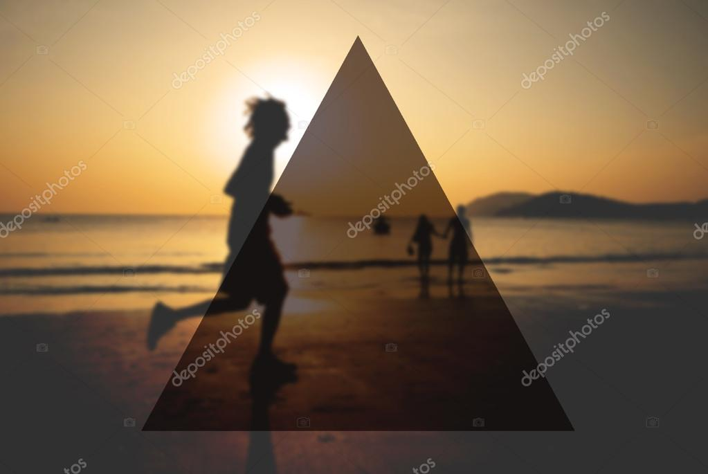man jogging on beach at sunset
