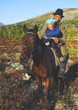 Mongolian Tsataan on Horse