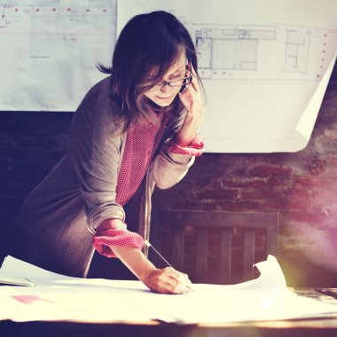 Architect Woman Working with Blueprints