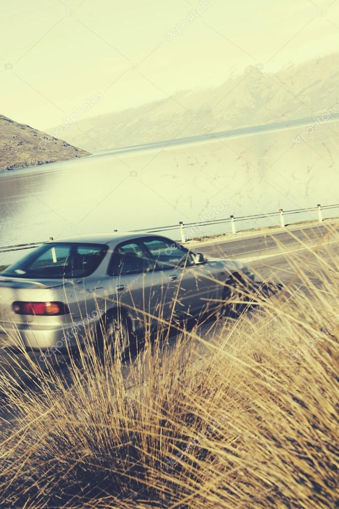 Car at Road near Lake