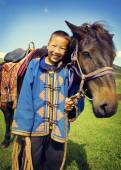 Photo Boy tilting head to horse