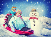 Children riding on snow sledge