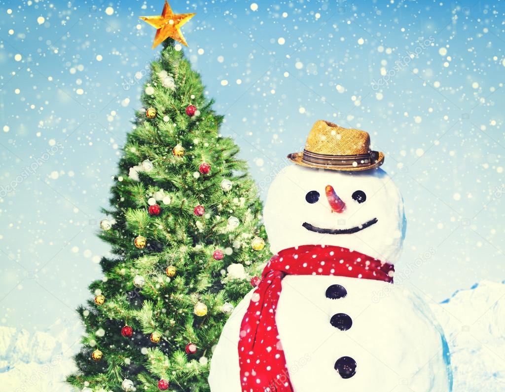 Real Snowman near christmas tree