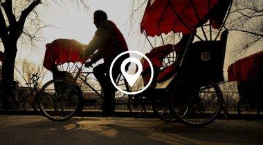 Man riding in Rickshaw