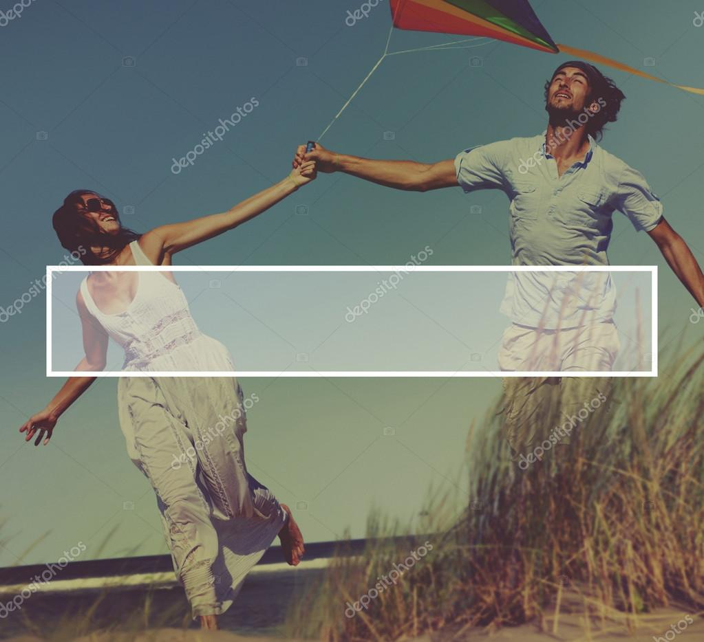 happy people with flying kite