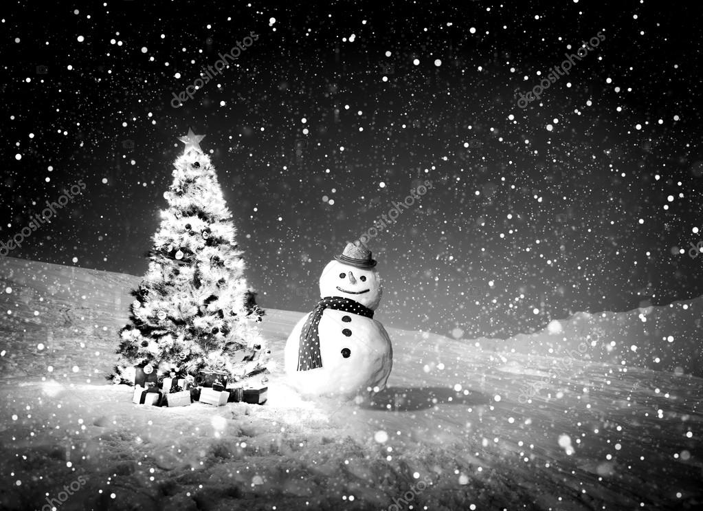 Real Snowman near christmas tree