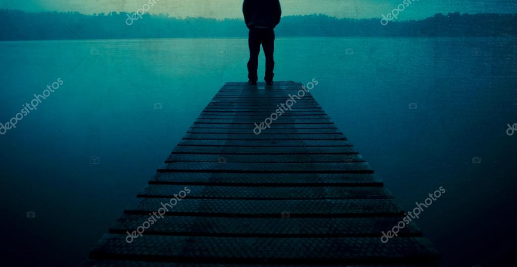 Man standing on a jetty