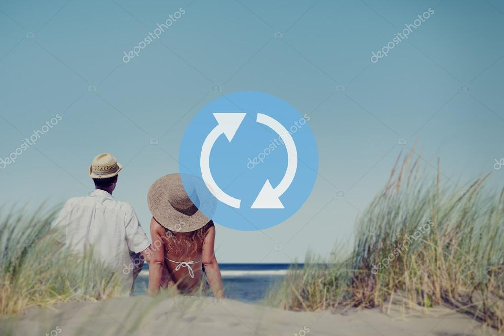 couple sitting at ocean
