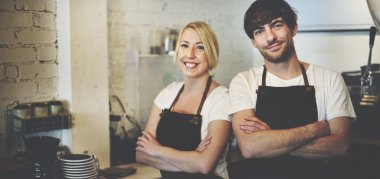 Woman and Man in Barista Cafe