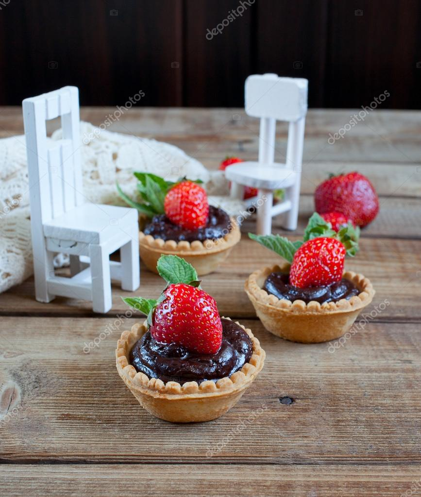 Strawberry tarts on the wooden table
