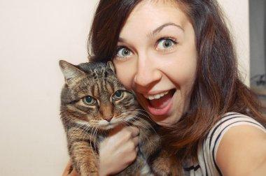 Funny smiling girl portrait with cat in studio stock vector