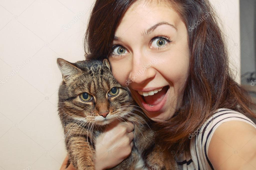 portrait of fuuny smiling girl with cat