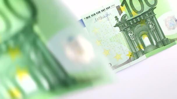 Euro banknotes falling down on white
