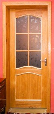 Door, the door covered with oak veneer