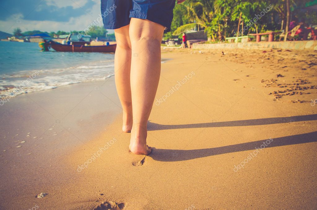 closeup women bare feet walking beach filter color vintage tone