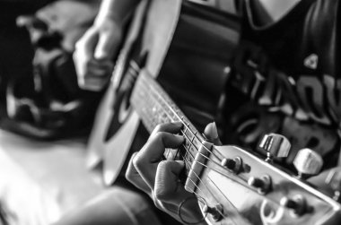 Female hand on classical guitar , black and white color