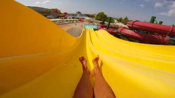 Yellow aqua slide in water park.