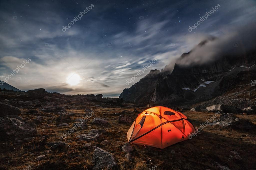 Orange tent in the mountains.