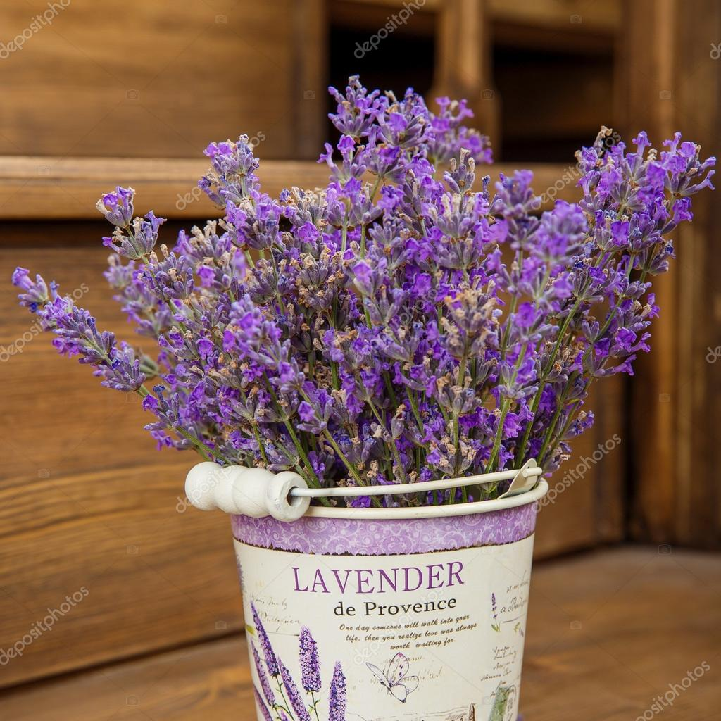 lavender in a  bucket  on an old wood stairs