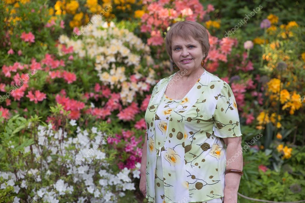 Pensioner woman in blossom garden