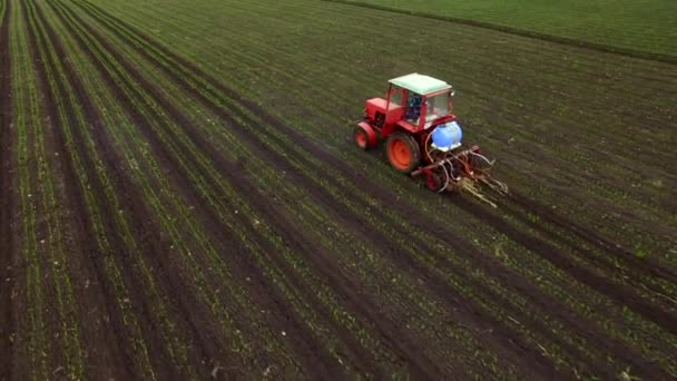 Aerial view of tractor sprays fertilizers