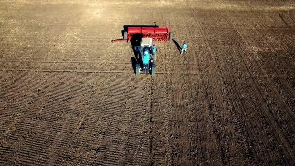 Aerial view of tractor sowing wheat