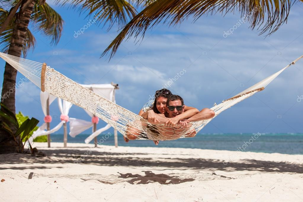 Romantic Couple Relaxing In Beach Hammock U2014 Stock Photo