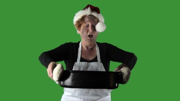 Küche-Katastrophen, Frau mit Schürze und Nikolausmütze