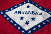 Photo Full frame close-up on a waving flag of Arkansas (USA) in 3D rendering.